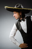Mexican man wears sombrero  on white Royalty Free Stock Image
