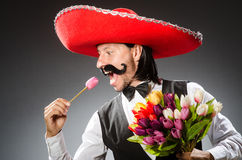 Mexican man wears sombrero  on white Stock Photography