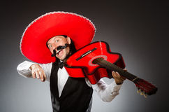 Mexican man wears sombrero  on white Stock Photos