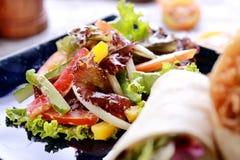 Mexican mango salsa with burritos. Close up portrait of mexican mango salsa with burritos stock images