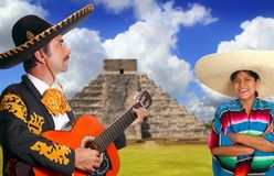 Mexican mariachi charro man and poncho Mexico girl Royalty Free Stock Images