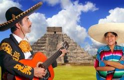 Mexican mariachi charro man and poncho Mexico girl. Chichen Itza Pyramid Royalty Free Stock Images