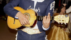 Mexican mariachi plays little guitar Royalty Free Stock Image