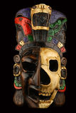 Mexican Mayan Aztec ceramic painted mask isolated on white. Mexican Mayan Aztec ceramic painted mask with skull isolated on black Royalty Free Stock Images