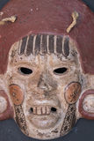 Mexican Mayan Aztec wood and ceramic mask. Women scary face on black background Stock Images