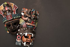 Mexican Mayan Aztec wood and ceramic mask. Women scary face on black background Royalty Free Stock Photo