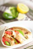 Mexican meal. Tasty Mexican fajitas burrito with grilled pork or chicken (white meat Stock Image