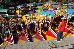 Mexican men sailing colorful Mexican gondolas at Xochimilcos Floating Gardens near Mexico City, Mexico Royalty Free Stock Photos