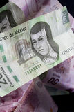 Mexican Money. Close up shot of mexican currency over black background Stock Photography