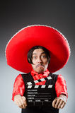 Mexican with movie board in funny concept Royalty Free Stock Photography