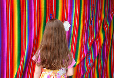 Mexican multicolor fabric and girl Stock Images