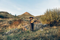 Mexican musician mariachi with guitar. Musician mariachi with guitar on the coast Royalty Free Stock Photography