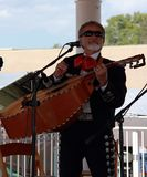 Mexican musician performing on the street concert in Taos stock photos