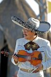 Portrait of a Mariachi Player Performing with a Violin for a Beach Audience Stock Photo