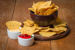 Mexican nacho chips and cheese and salsa dip in bowl Royalty Free Stock Photography