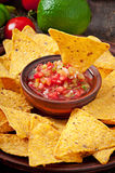 Mexican nacho chips and salsa dip Royalty Free Stock Images