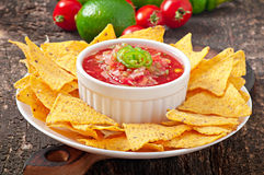 Mexican nacho chips and salsa dip Stock Image