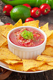 Mexican nacho chips and salsa dip Stock Photography