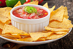 Mexican nacho chips and salsa dip Royalty Free Stock Photography