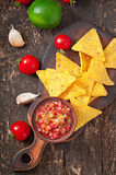 Mexican nacho chips and salsa dip Stock Photos