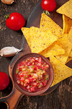 Mexican nacho chips and salsa dip Stock Images