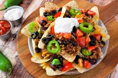 Mexican nacho chips on a wooden paddle board Stock Image