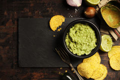 Mexican nachos chips with fresh guacomole sauce Stock Image