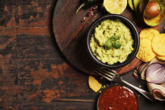 Mexican nachos chips with homemade fresh guacomole sauce and sal Royalty Free Stock Images
