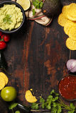 Mexican nachos chips with homemade fresh guacomole sauce and sal Royalty Free Stock Image