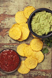 Mexican nachos chips with homemade fresh guacomole sauce and sal Stock Photo
