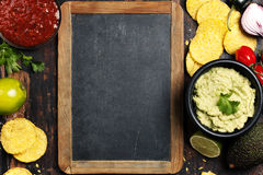 Mexican nachos chips with homemade fresh guacomole sauce and sal Royalty Free Stock Photo