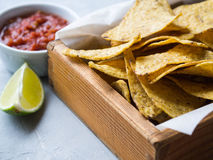 Mexican nachos chips with salsa sauce in wood box stock images
