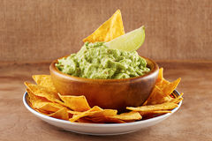Mexican nachos with handmade guacamole sauce Stock Photography