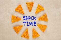 Free Mexican Nachos Or Tortilla Chips Designed As A Clock Pointing Towards The Snack Time Text Stock Images - 183026094