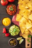 Mexican nachos tortilla chips with guacamole, salsa and cheese d stock image