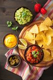 Mexican nachos tortilla chips with guacamole, salsa and cheese d. Ip royalty free stock photos