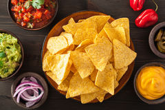 Mexican nachos tortilla chips with guacamole, salsa and cheese d Royalty Free Stock Photography