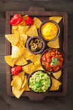 Mexican nachos tortilla chips with guacamole, salsa and cheese d Royalty Free Stock Image