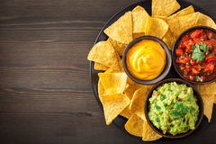 Mexican nachos tortilla chips with guacamole, salsa and cheese d Royalty Free Stock Photos