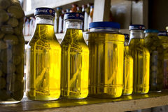 Mexican olive oil in recycled jars royalty free stock images