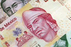 Mexican One Hundred Peso Plastic Bill. New 100 peso mexican bill made of plastic, aside from other bills Stock Image