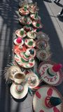 Sombreros in the street. Mexican palm hats called sombreros, decorated with the national colors of mexico and phrases all over it lays in the floor to be sold to stock images
