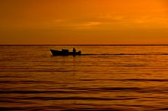 Mexican Panga. Fisherman's Panga crosses a tropical calm bay in early morning Royalty Free Stock Photography