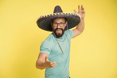 Mexican party concept. Man cheerful happy face in sombrero hat celebrating yellow background. Guy with beard looks. Festive in sombrero. Party and holiday stock images