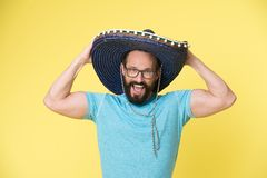Mexican party. Man on smiling face in sombrero hat celebrating, yellow background. Guy with beard looks festive in. Sombrero. Fest and holiday concept. Man in royalty free stock photos