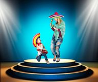 Mexican party. A small boy in a sombrero plays the guitar and sings a serenade for his mother. A small boy in a sombrero plays the guitar and sings a serenade stock photography