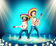 Mexican party. Two brothers in sombreros perform on stage, sing serenades. Two brothers in sombreros perform on stage, sing serenades.Mexican party royalty free stock photography