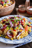 Mexican pasta salad with red bean, corn, tomato, onion and peppe Royalty Free Stock Photos