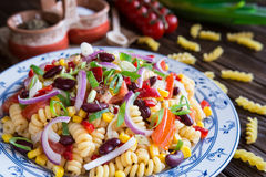 Mexican pasta salad with red bean, corn, tomato, onion and pepper. Vegetarian Mexican macaroni pasta salad with red bean, corn, tomato, onion and pepper stock photo