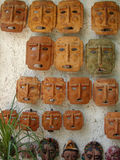 Mexican Patio Faces. Traditional clay masks in a Mexican patio shop in Guadlaljara, Mexico Stock Images